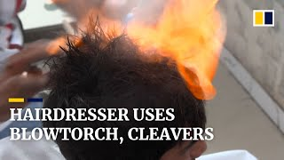 EUROPESE OMROEP | OPENN  | Pakistan barber offers hair-raising cuts with cleavers and blowtorch