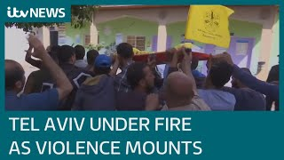 EUROPESE OMROEP | OPENN  | Tel Aviv under fire and Gaza Tower block hit by air strike as violence mounts | ITV News